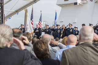 The Coast Guard commissioning party salutes the American flag during a ceremony to commission Coast Guard Cutter Hamilton, the first National Security Cutter to be stationed on the East Coast, Dec. 6, 2014. Hamilton is the Coast Guard's fourth 418-foot Legend-Class National Security Cutter. (Coast Guard photo by Petty Officer 1st Class Stephen Lehmann)