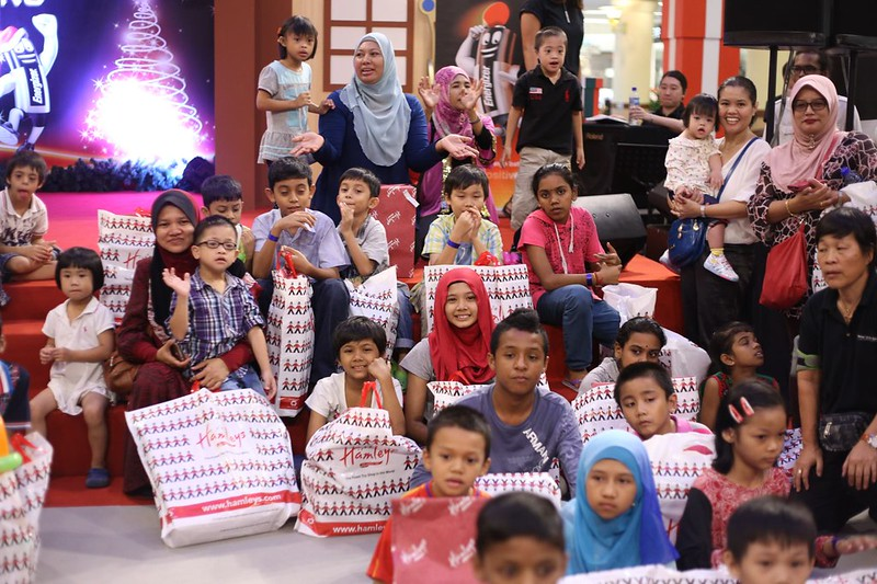 The VIPs of the day - the children of Kiwanis Malaysia - show off their new battery operated Christmas presents
