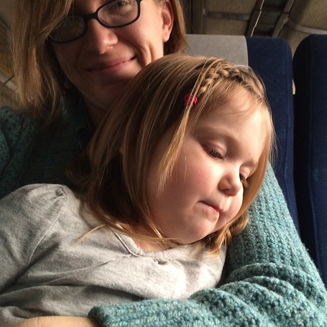 Tired mama, wiggly kiddo, on a train. It's gonna be a LONG day. #winterbreak2014