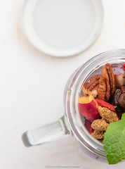 Jug with yogurt and organic kernel and fruit mix.…