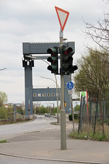 street sign(0.0), advertising(0.0), signage(1.0), light fixture(1.0), signaling device(1.0), transport(1.0), sign(1.0), street light(1.0), traffic sign(1.0), lighting(1.0), traffic light(1.0),