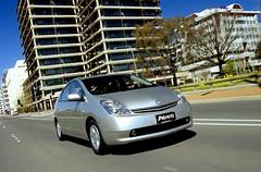 minivan(0.0), sedan(0.0), automobile(1.0), automotive exterior(1.0), toyota(1.0), vehicle(1.0), compact car(1.0), bumper(1.0), toyota prius(1.0), land vehicle(1.0),