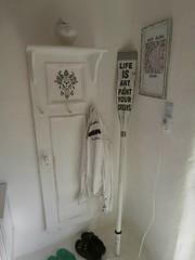 Stenciled coat rack made from cabinet door