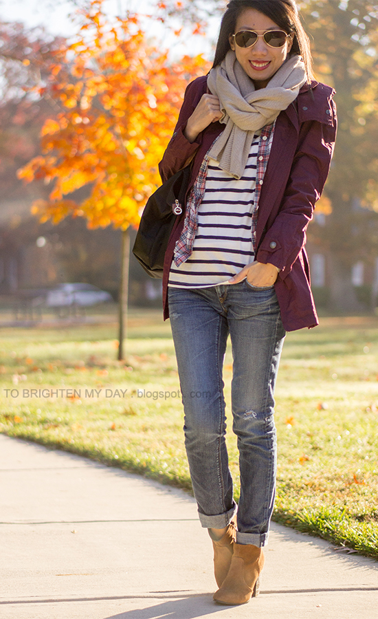 taupe chunky scarf, dark red jacket, plaid shirt, striped tee, suede ankle boots