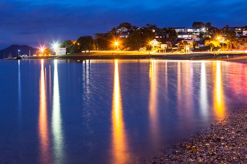 longexposure light sea newzealand summer seascape reflection beach night canon landscape lights coast cove shoreline 85mm auckland shore coastline nightsky bucklandsbeach theparade