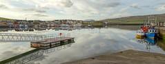 Scenic reflections at Dingle harbor, County Kerry, Ireland