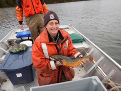 Carey Edwards, biologist from Iron River National Fish Hatchery, Wisconsin, poses with a beautiful coaster brook trout
