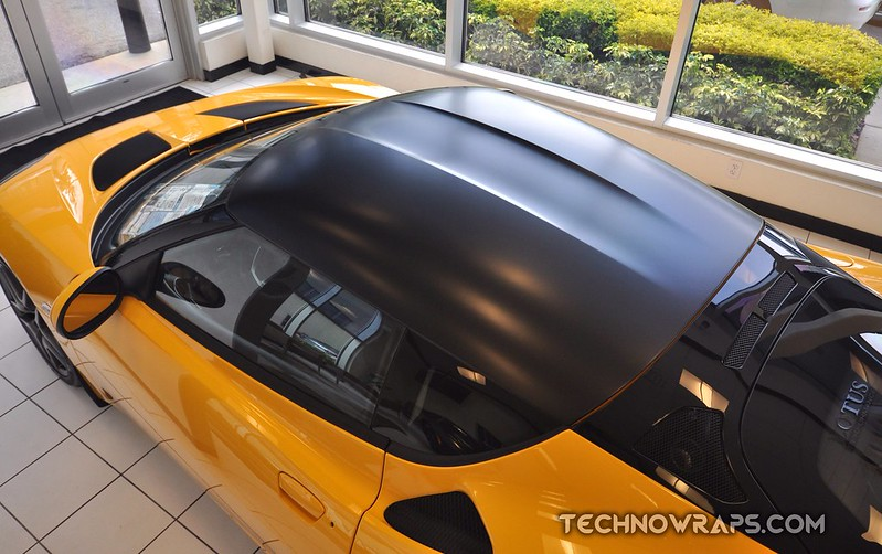 Car roof wrap in 3M Black Satin vinyl by TechnoSigns