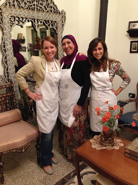 Rachelle posing with chefs at a cooking class in Amman.