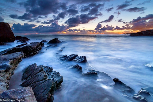 ocean california sunset seascape storm beach water clouds canon point landscape moss rocks waves angle wide tokina shore 7d laguna lagunabeach 1116 mosspoint exposureblend seasunclouds canon7d tokina1116f28 photoclevercom