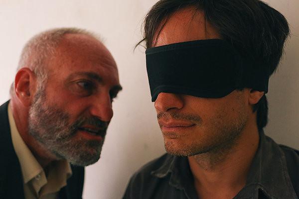 Kim Bodnia and Gael García Bernal play emotional tug of war in ROSEWATER.