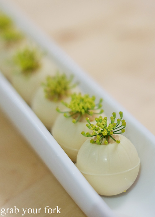 White chocolate balls with foie gras and fennel flower at the Stomachs Eleven Christmas dinner 2014