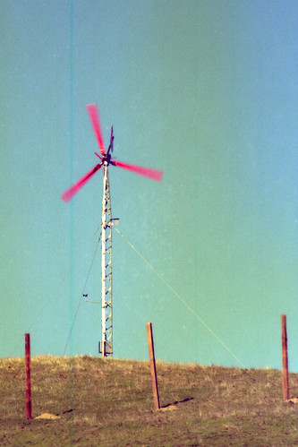 windmill scannedfilmnegative charliewambekephotography nikonfe2photo personalelectricgeneratingwindmillin1976 windmillonahill windmillseenfromoutdoors