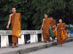 monks crossing a bridge