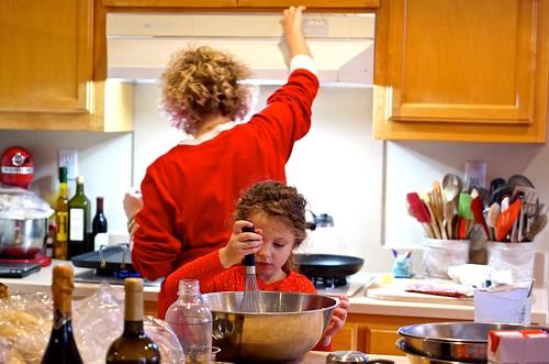 Hazel helps Jenn prepare pancakes