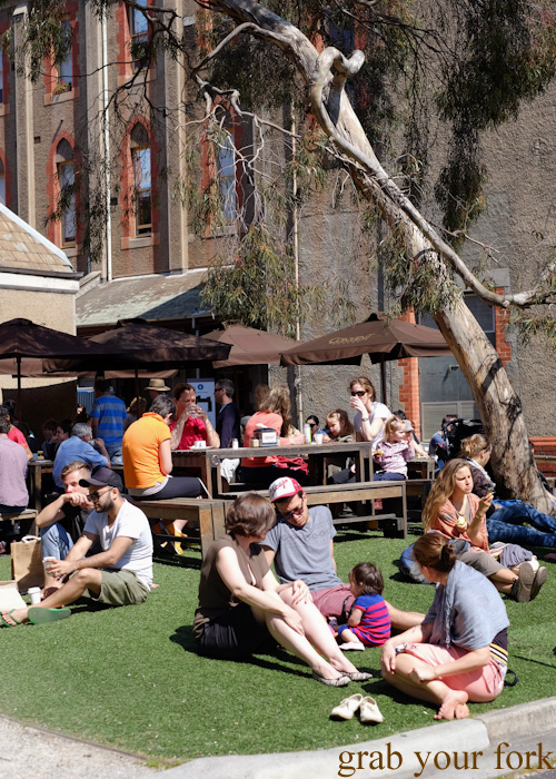 Shoppers on the lawn at Abbotsford Convent Slow Food Farmers Market