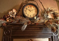 furniture(0.0), picture frame(0.0), cuckoo clock(0.0), carving(1.0), decor(1.0), wood(1.0), christmas decoration(1.0), clock(1.0),