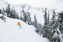 Riding fresh lines off of Whistler Peak