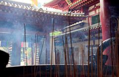Incense burnign in urn, Buddha Tooth Relic Temple