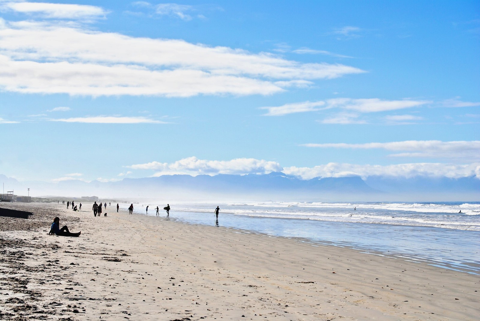 Surfers at Muizenberg Beach, South Africa.