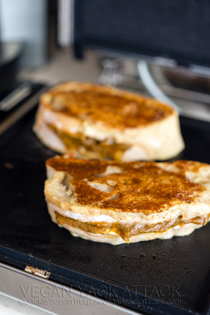 Stuffed French toast cooking on a griddle