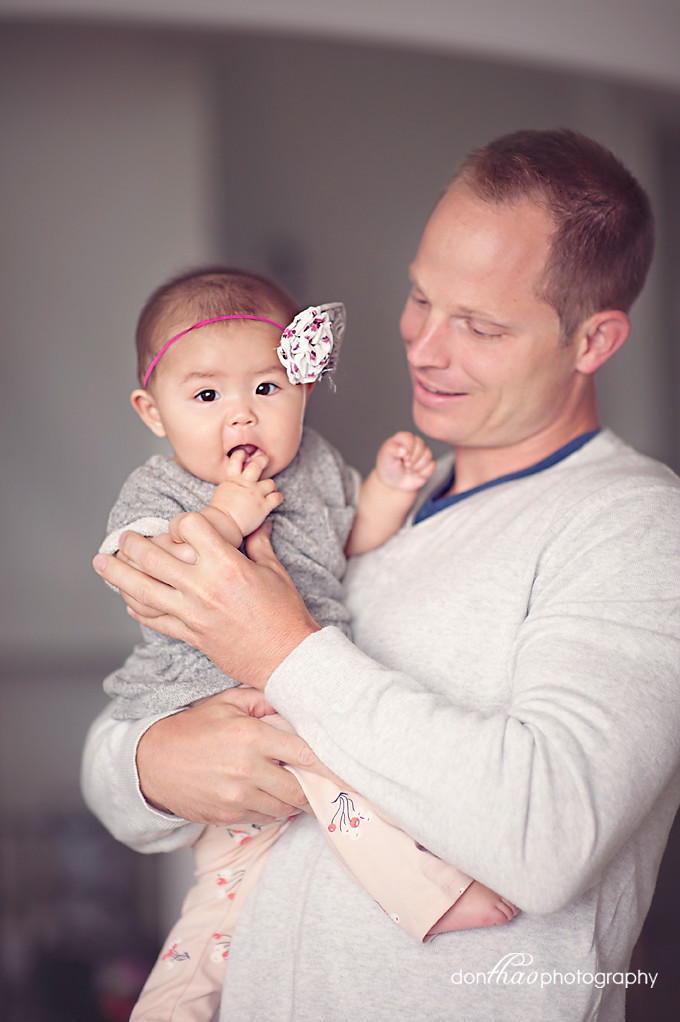 father with baby girl in Hudsonville family photography