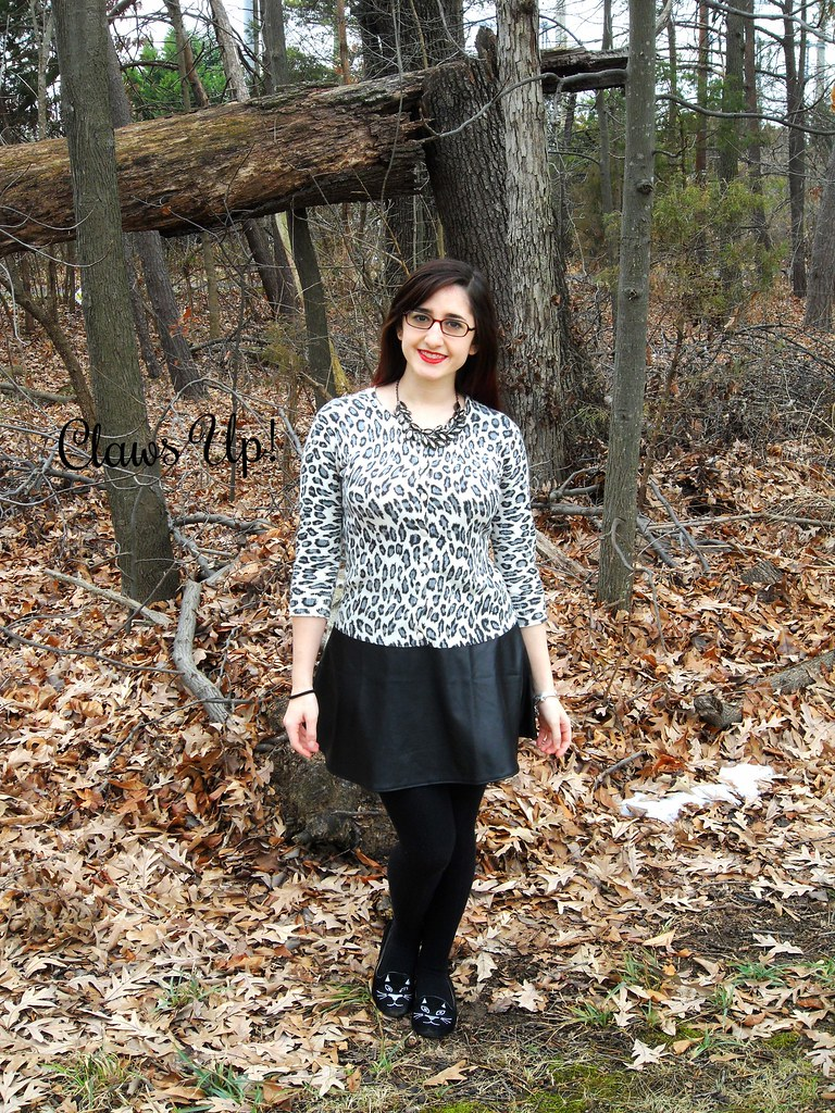 White leopard print cardigan, faux lather skirt, and cat face shoes