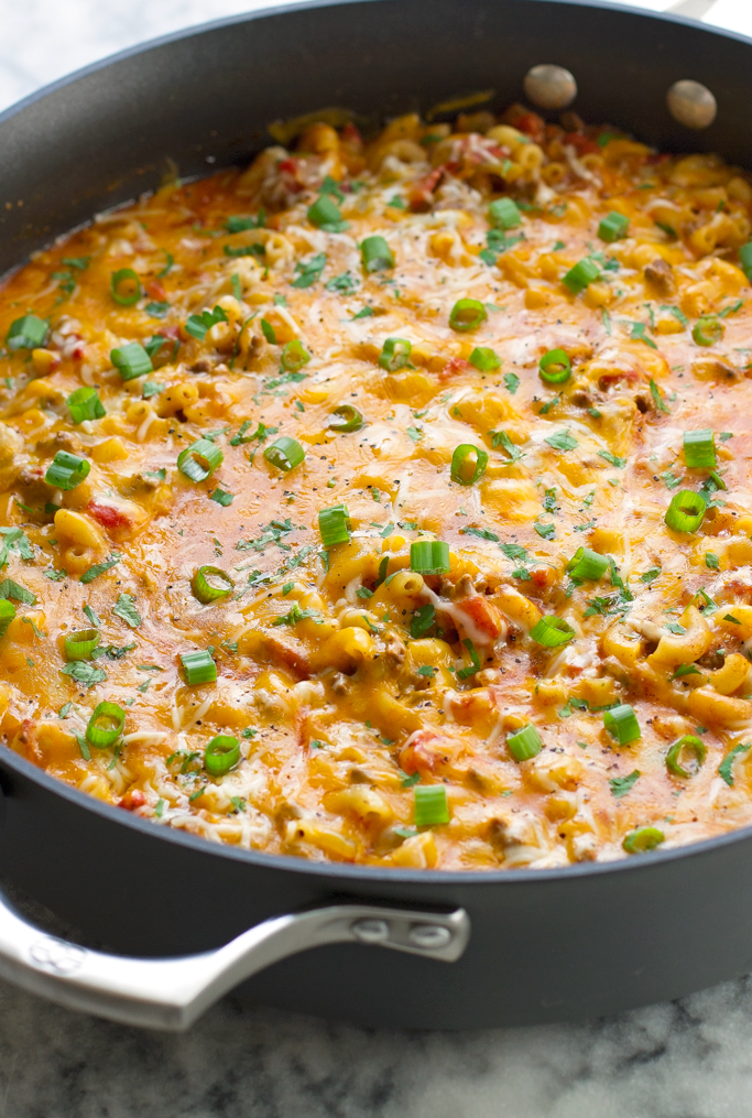One Pot Chili Con Queso Mac and Cheese - loaded with seasoned ground beef, melty, gooey cheese, the whole family is going to love this! #macandcheese #macaroniandcheese #hamburgerhelper #chiliconqueso   littlespicejar.com