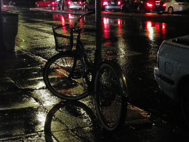bicycle with a wire basket on a rainy street; 9th and Lincoln, The Sunset, San Francisco (2014)