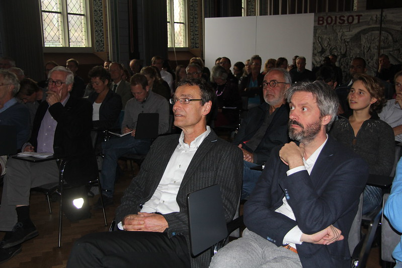 The audience listening to the speakers