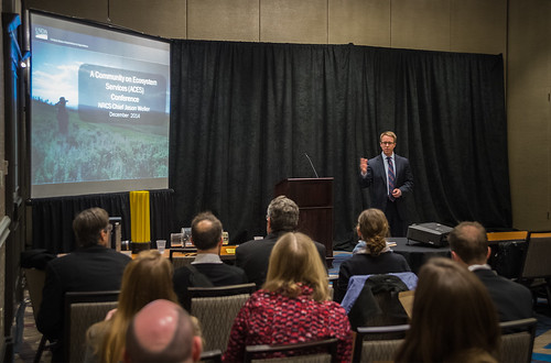 At the ACES conference last week, NRCS Chief Jason Weller (standing) outlined USDA's approach to incorporating ecosystem services and environmental markets into its conservation mission. USDA Photo by Bob Nichols.