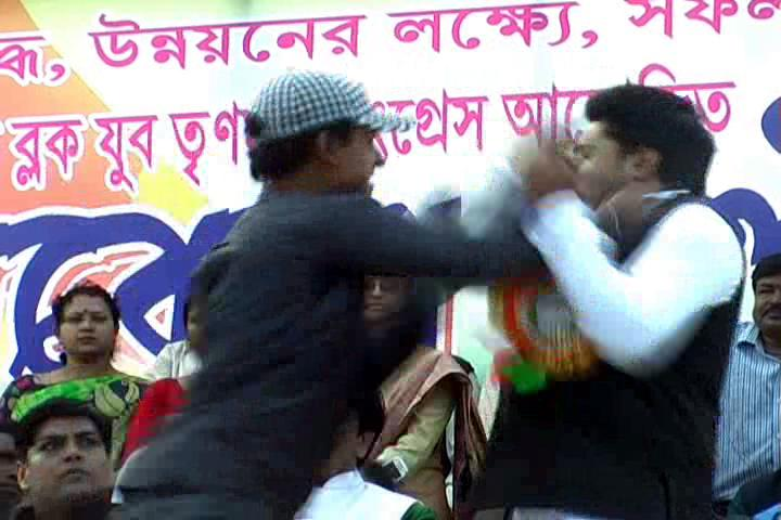 A man slaps Abhishek Banerjee at a meeting in East Midnapore. Credit: IANS