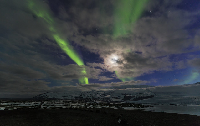 Aurora borealis, moonlight and clouds