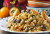 Plov with lamb meat, quince and raisins