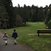 Small photo of Scott and Elain walking on the golf course