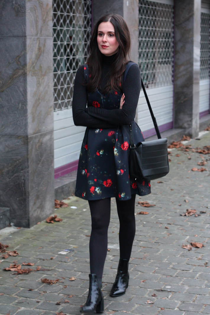 floral dress layered over turtle neck, patent chelsea boots