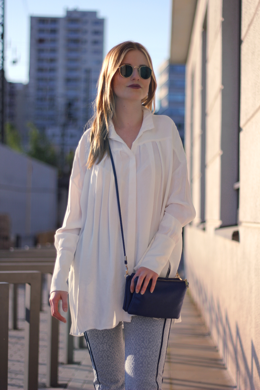outfit white and other stories blouse barre noire trousers blue spring urban outfiters trio bag ray ban