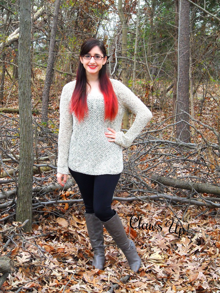 Tall gray boots, black leggings, and beige sweater