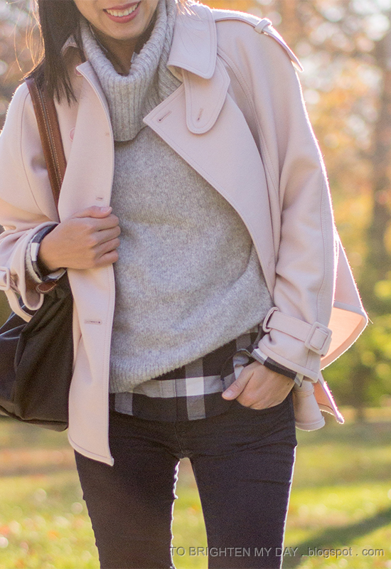 pink trench cape, gray sweater, navy plaid shirt