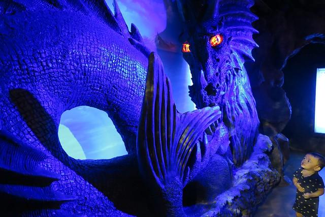 James checking out the big dragon like monster.