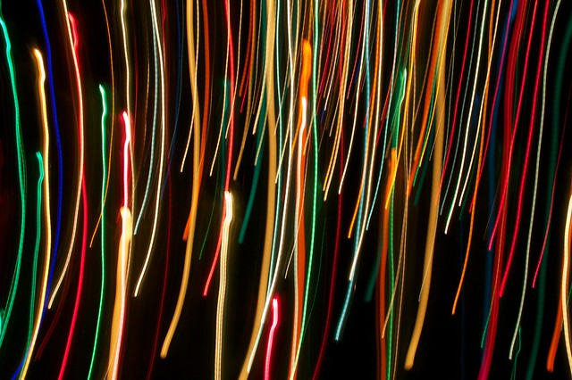 Photo of winter tree lights physically blurred by moving camera while shutter open.
