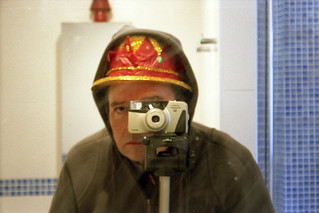 reflected self-portrait with Yashica Microtec Zoom 90 camera and too much headgear