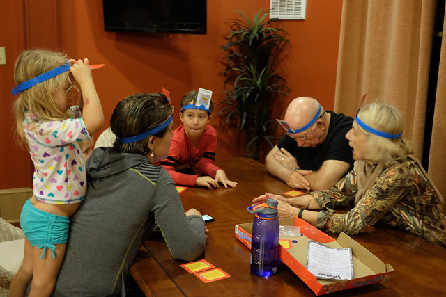 Family playing the headbands game