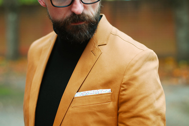 Menswear: Camel blazer, black roll neck and jeans