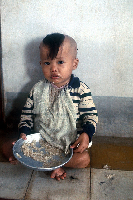 SAIGON 1968 - Vietnamese orphan eats his meal