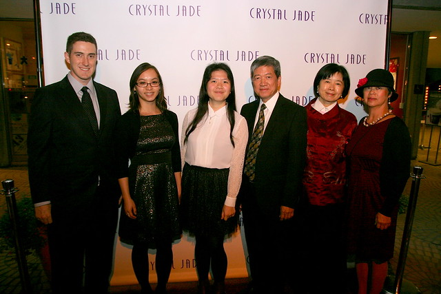 Mr Ip (fourth from left) flanked by daughter and wife