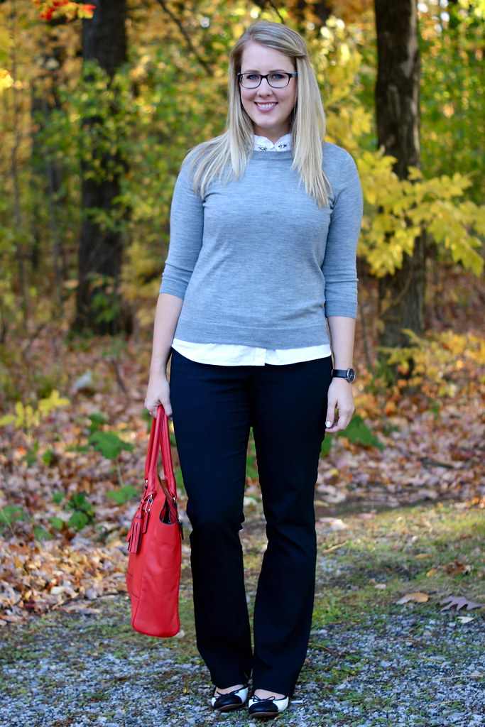 grey sweater layered over white blouse