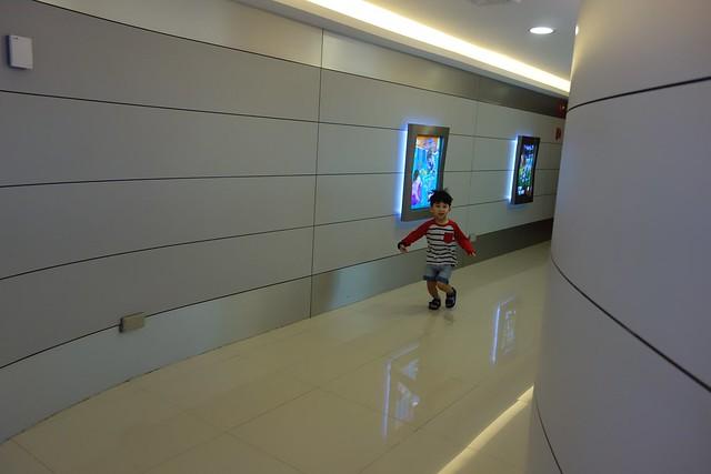 Excited Jerry running through the walkways into KidZania