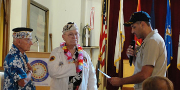 SAN DIEGO – The commanding officer of the dock landing ship USS Pearl Harbor (LSD 52) administered the oath of office to four executive board members of the Pearl Harbor Survivors Association (PHSA), Carnation Chapter 3, during a ceremony in San Diego.