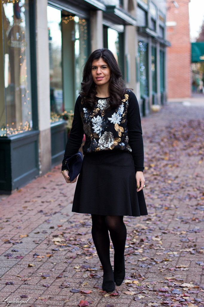 sequined sweater, black flippy skirt, clare v clutch.jpg